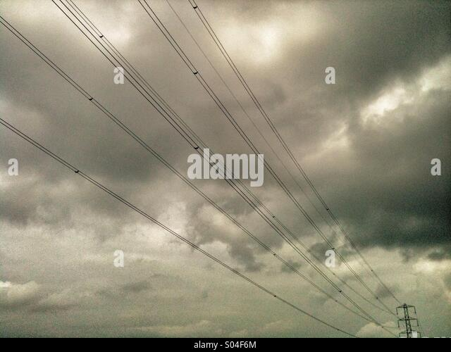 Electricity power lines and grey sky. - Stock Image