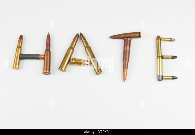 Bullets spelling out the word 'hate'. - Stock Image