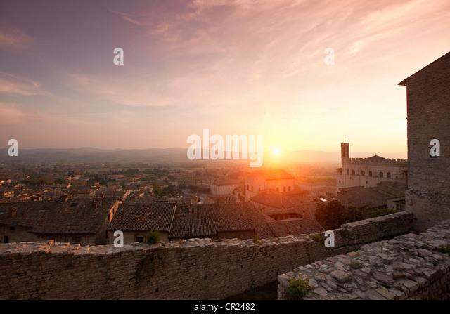 Sun shining over stone city walls - Stock Image