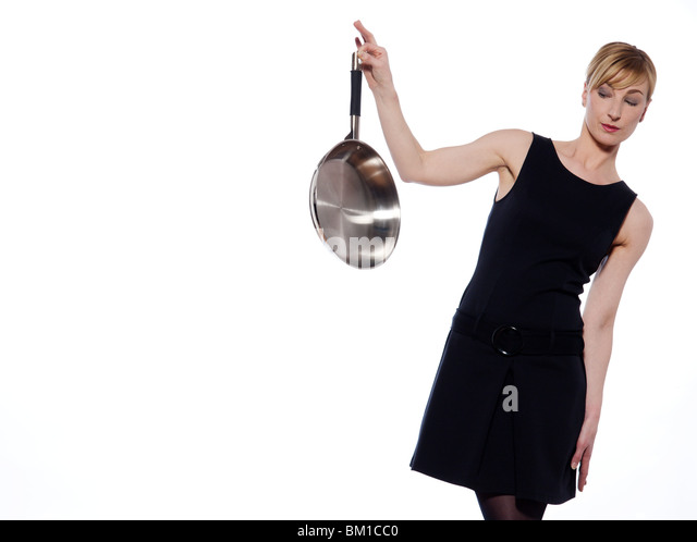 beautiful woman on studio white background holding a frying pan - Stock Image
