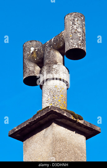 Asbestos H-chimney pot - France. - Stock Image