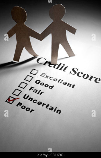 Credit Report and Paper Chain People - Stock Image