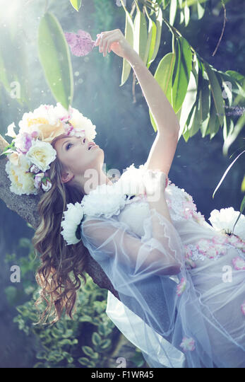 Gorgeous ypung woman with the flowery dress - Stock-Bilder