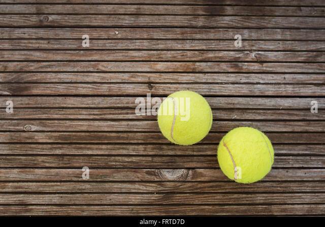 Tennis balls on wooden background - Stock-Bilder