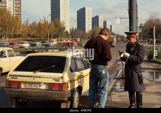 Russia former Soviet Union Moscow traffic patrol writes ticket stopped motorist - Stock Image