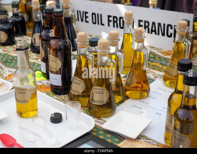 Bottles of Olive oil for sale at food festival in Bakewell Derbyshire England - Stock Image