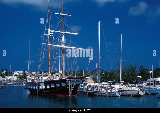 Tall ship modern sailboats size contrast Bahamas Abaco Man O War Cay marina - Stock Image