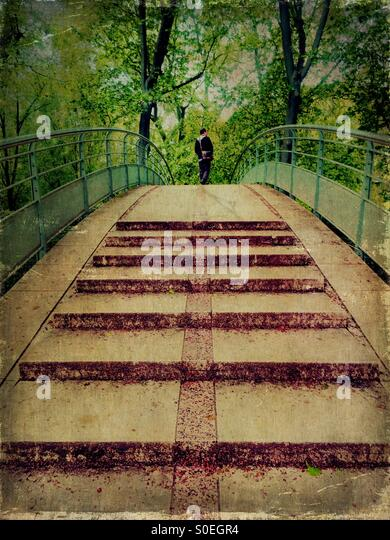 Man crossing an overpass pedestrian bridge at Bercy in Paris, France. Vintage texture overlay. - Stock Image