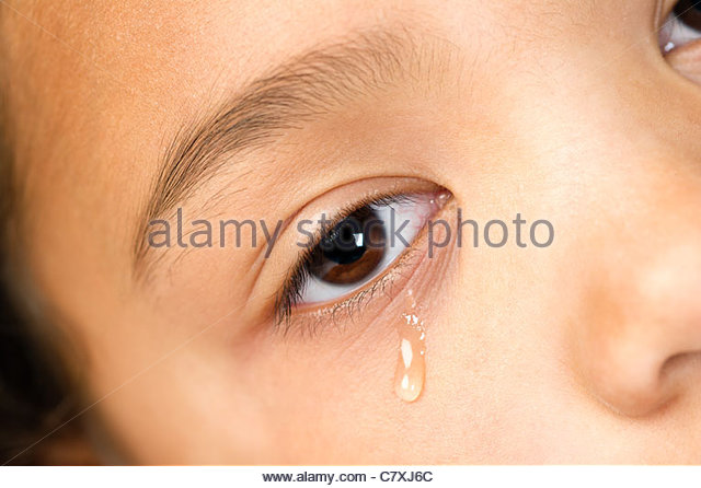 close up of the eye of a young girl crying - Stock Image