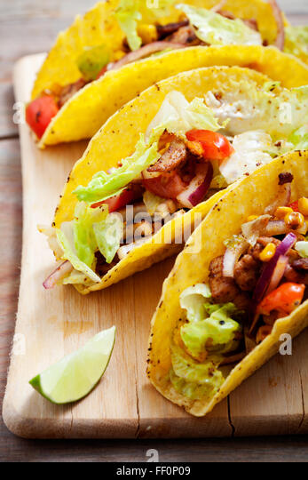 Fresh Mexican tacos with spicy chicken - Stock Image