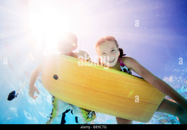 kids swimming underwater - Stock Image
