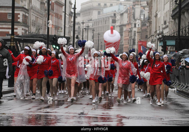 London, UK. 1st January 2017. Cheerleaders carry on despite the rain on Picaddilly at the  New Year's Day Parade - Stock Image