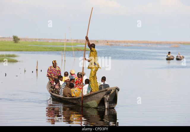 Boat with passengers, near Ganvie lake village on Nokoue Lake, Benin, West Africa, Africa - Stock Image