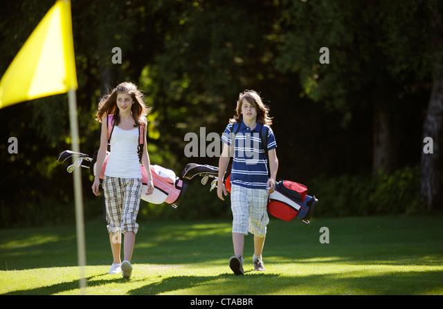 Children playing golf, Bergkramerhof, Bavaria, Germany - Stock Image