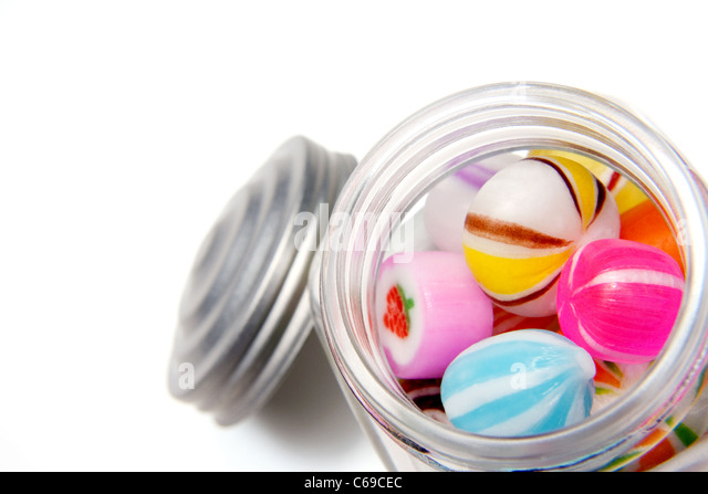 Candies inside Glass Jar - Stock Image