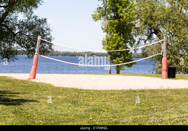 Empty beach volleyball court in front of Cameron Lake in Fenelon Falls Ontario - Stock Image