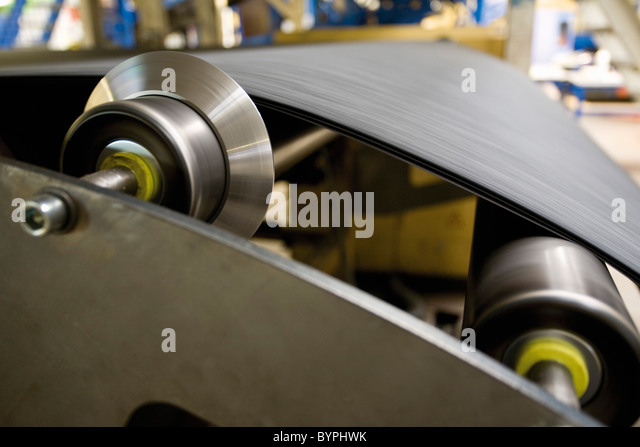 Carpet tile factory, backing process - Stock Image