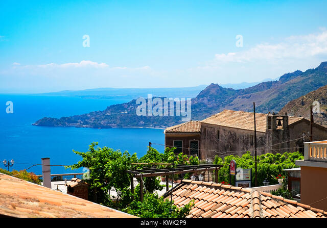 coast view from the mountain village of forza d'agro near messina on the island of sicily, italy. - Stock Image