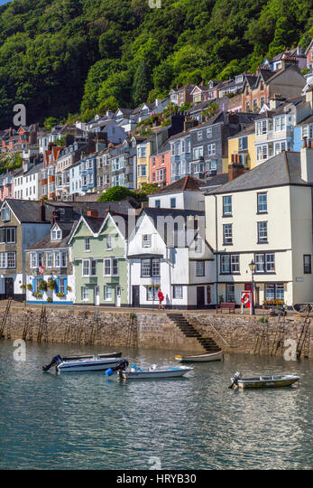 A postman delivers letters to the colourful houses lining the riverside at and above Bayards Cove in Dartmouth, - Stock Image