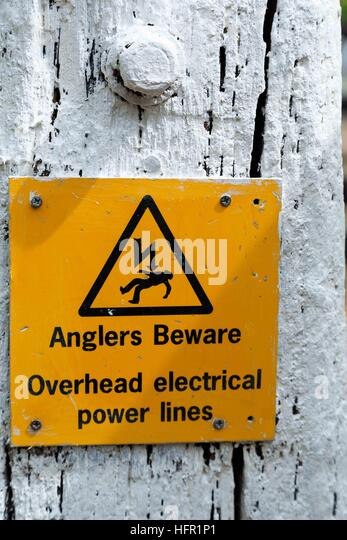 Angler's beware of dangerous overhead cables when fishing. - Stock Image