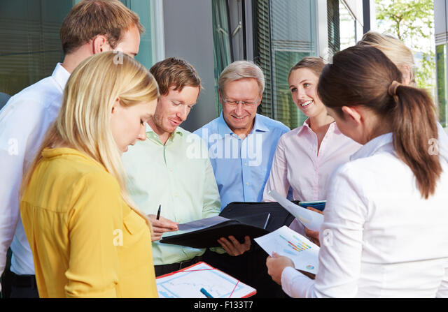 Business people group doing teamwork outside the office - Stock Image