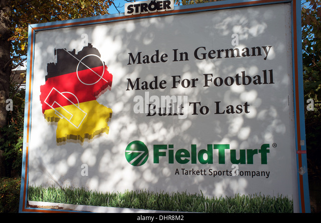 Billboard with advert for Field Turf - Stock Image