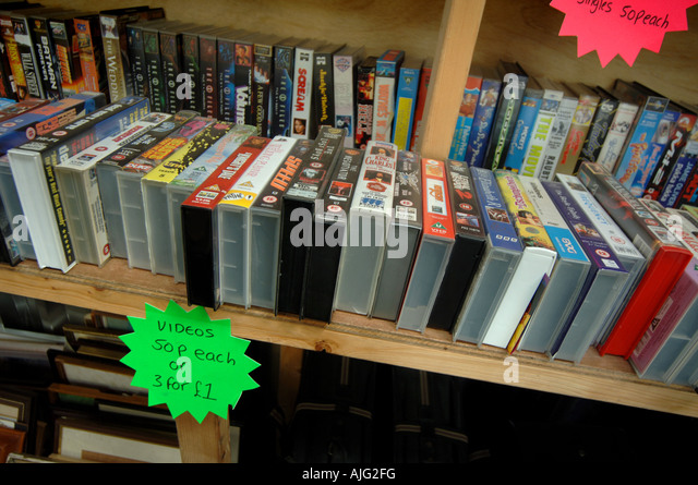 Rows of video tapes of films for sale at a recycling centre in Bideford, North Devon. - Stock Image