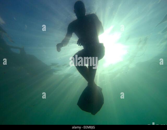 Swimming in ocean - Stock Image