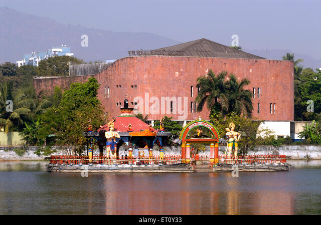 Ram Ganesh Gadkari Rangayatan Marathi drama theatre with reflection in water of Masunda lake or Talao Pali ; Thane - Stock Image