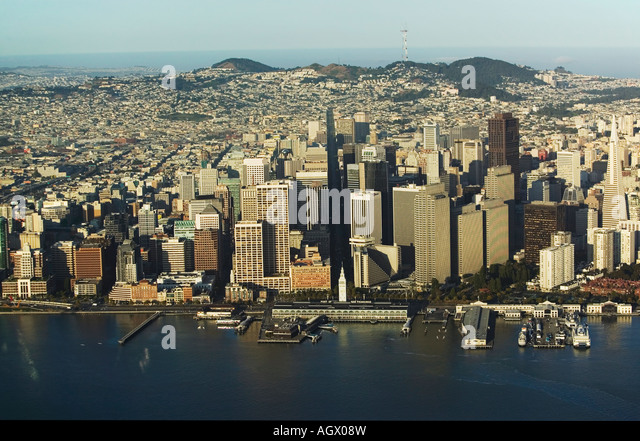 aerial above Embarcadero waterfront San Francisco from the bay with Embarcadero Center and ferry building in the - Stock Image