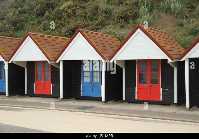 Bournemouth, UK -  11 May: A array of beach huts located in Bournmouth beach. General view of the seaside town - Stock Image