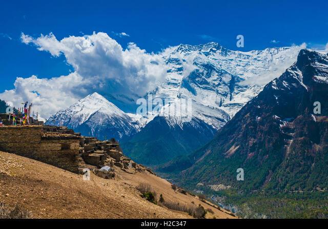 Landskape Photo Tracking Himallaya Vilage Side Hill.View Snow Nepal Mountans Background. Hikking Sport Travel. Horizontal - Stock Image