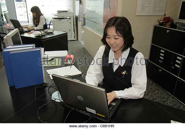 Tokyo Japan Shinjuku Shinjuku NS Building office worker Asian woman laptop computer job employee - Stock Image