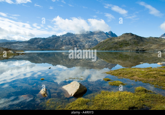 Reflections in the lake of Qordlortoq Sø, Angmagssalik Island, Sermilik Fjord, East Greenland - Stock Image