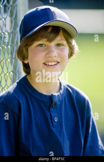 Portrait of 12 year old boy baseball player. - Stock Image