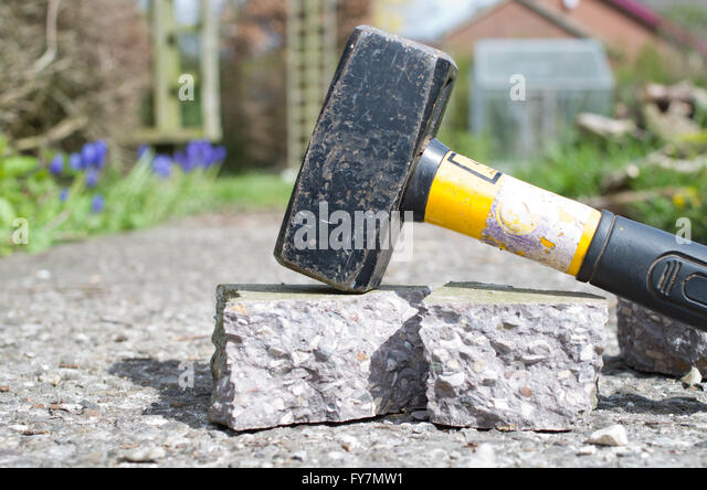 Hammer breaking up concrete - Stock Image