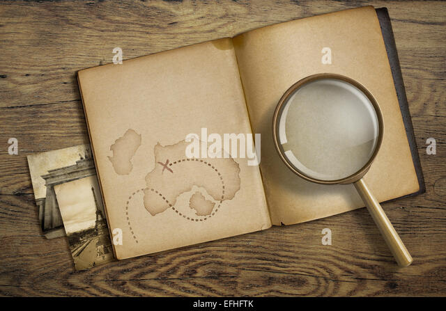 Adventure and travel theme. Diary with magnifying glass or loupe. - Stock-Bilder