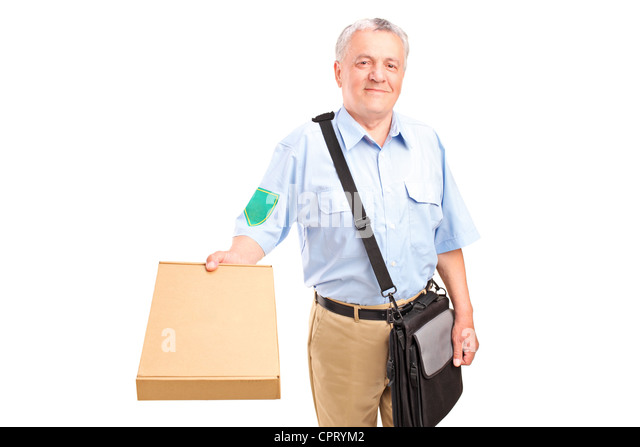 A mature postman delivering parcel isolated against white background - Stock Image