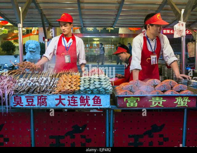 Food stalls, Donganmen night food market, near Wangfuging Dajie, Beijing, China - Stock Image