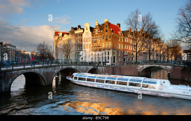 Tourist boat on Prinsengracht Canal Amsterdam Holland - Stock Image