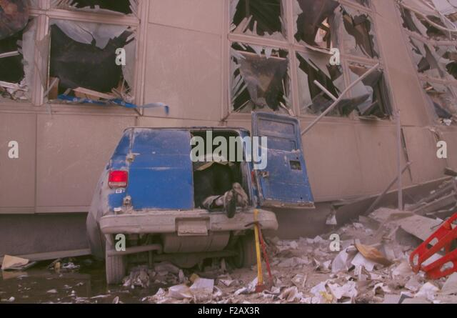 Fireman checking inside the back of a van after 9-11 terrorist attack in New York City. The van's front was - Stock-Bilder