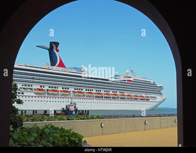 Carnival Conquest cruise ship at port of Amber Cove in Dominican Republic. - Stock-Bilder