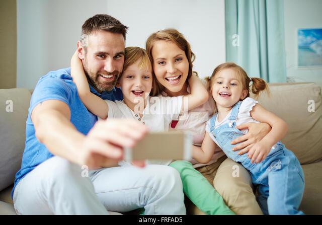 Selfie of happy family - Stock Image