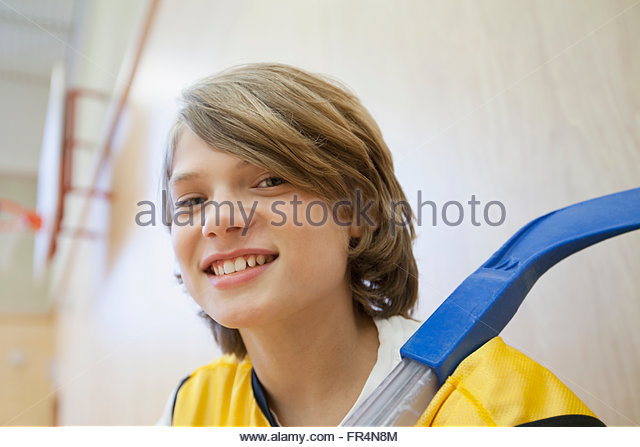 Portrait of male, floor hockey player. - Stock Image