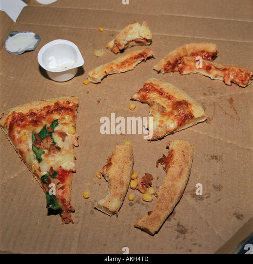 Pizza crusts left in a box - Stock Image