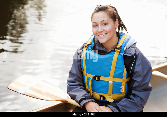 Woman sitting in canoe - Stock Image