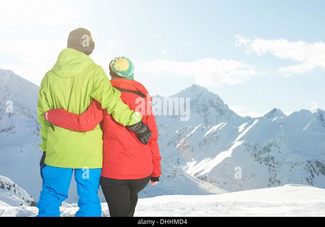 Couple looking at mountains, Kuhtai, Austria - Stock Image