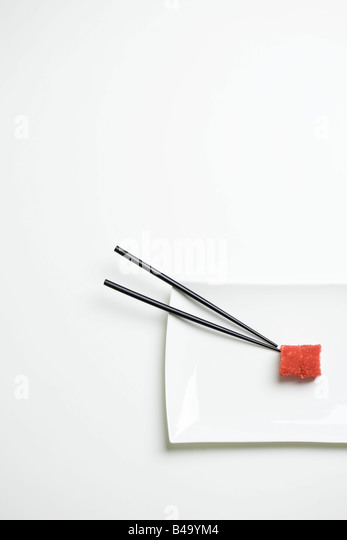 Maki sushi and chopsticks on sushi plate, overhead view - Stock-Bilder
