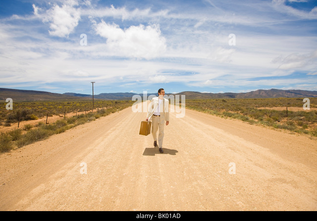 Lonely man, lonely road - Stock Image