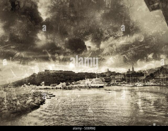 Mgarr harbour with storm approaching - Stock Image
